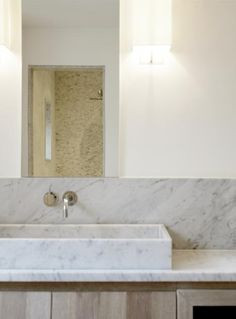 marble in the bathroom | modern bathroom | bathroom pictures bycocoon.com | Vola wall mounted basin mixer | Inspiration by Dutch Designer brand COCOON