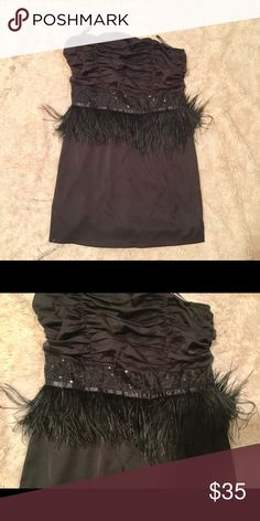 Strapless dress Chic strapless dress embellished with sequined and  feather waistband. Never worn.  NWT.   Large. Cluce Dresses Strapless