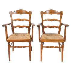 Bring pastoral elegance to any room with these vintage French side chairs, showcasing farmhouse-style silhouettes and woven rush seats