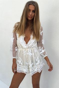 The stunning Sequin Mae Playsuit features a cream underlay with an off-white mesh overlay with sequin detailing throughout. It features a plunging V neckline, 3/4 length sleeves and elasticated arm cuffs and waist band. Pair with neutral heels for your next event!
