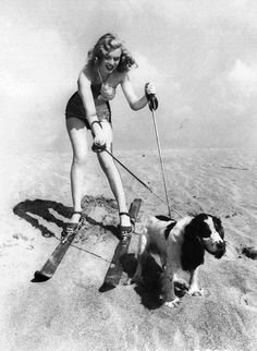 Marilyn Monroe wearing skis at the beach with her dog Ruffles 1947