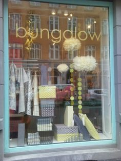 Bungalow.dk shop in Copenhagen with Pom Pom from Stjernestunder.dk and paper boxes from Bungalow.dk in soft yellow and gray Shades. April 2013.
