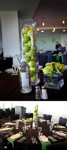 Tall vase filled with green apples to use on top of bookcase divider