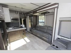 Keystone Raptor toy hauler 423 highlights: Outdoor Kitchen Separate Garage Loft Exterior TV Master Suite With this Raptor toy hauler, you will. Raptor Toys, Fifth Wheel Toy Haulers, Ocala Florida, Garage Loft, Electric Awning, Modern Toys, Keystone Rv, Open Layout, Electrical Wiring