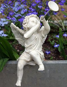 Sitting Cherub Blowing Horn (Left)