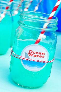 Throwing a fun summer event or maybe even a Shark Party? Quickly make this easy Blue Punch recipe and print the cute free label to name it Ocean Water! | The Love Nerds