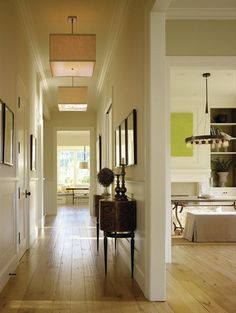 New, taller doorways maximize the penetration of natural light. An eclectic mix of lighting fixtures adds a contemporary touch.