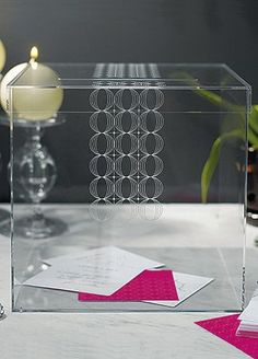 """This contemporary acrylic box creates a sophisticated Wishing Well that will work with any color theme and coordinating personalized note cards are the perfect complement. It can be used as a Well for guests' wedding cards or as a memory box for all your wedding keepsakes.  Features and Facts:   Size:9 3/4""""x 9 3/4"""" x 9 1/2"""" H.  Opening on top of box suitable for average card size.  Lid is able to come completely off.  Personalized Wishing Well Cards not Available.  Made of acrylic."""