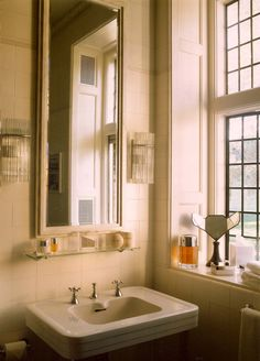 Tobin Clark Estate.Vanity New Mirror And Faux Tile Above.