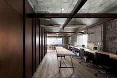 Suppose Tokyo Office is a minimalist interior located in Tokyo, Japan, designed by Suppose Design Office. The space is comprised of industrialized materials such as old scaffold board for the flooring, and an exposed concrete wall. (2)
