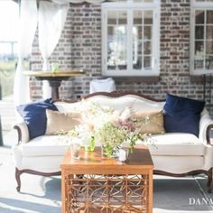 Dress up our outdoor event space like you would the indoor! Create a comfy place for your friends and guests to relax while enjoying the #waterfront views! #HistoricRiceMill #weddingdecor