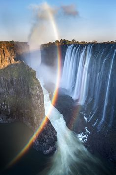A stunning spray rainbow (one that is formed by the refraction and reflection of the suns rays in raindrops) emerges over Victoria Falls at sunrise Mosi-oa-Tunya National Park Zambia [600900] Photo by Ian Plant #reddit