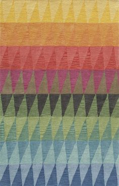 Triangular shapes in different, colorful hues, are positioned across the rug to create a dimensional and graphic design, suited for a modern and vibrant home.