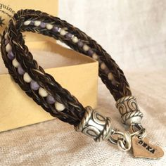 This trendy bracelet will be created just for you when you order it. It features strands of horse hair, individually counted and plated together into two square braids. A string of 4mm Czech glass bea