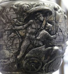 Achilles dragging Hector's body in front of the Gates of Troy. Detail of a silver oinochoe dedicated by Q. Domitius Tutus, made in Italy, first half of the 1st century AD. From the Berthouville treasure.
