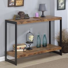 The Industrial console table features a rustic wood finish laminite top with metal sides. The wood and metal design provide functionality and style.