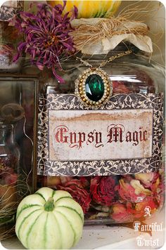 Gypsy Magic    dried roses/flowers; sprinkled some magenta glitter into the jar for effect. hang an antique necklace around the jar