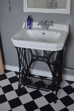 Early Century Singer sewing machine base installed into bathroom with basin mounted on top Singer Sink. Early Century Singer sewing machine base installed into bathroom with basin mounted on top Sewing Machine Tables, Treadle Sewing Machines, Antique Sewing Machines, Repurposed Furniture, Diy Furniture, 1920s Bathroom, Bathroom Sinks, Bathrooms, Bathroom Lighting