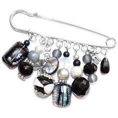 Handgemaakte kiltspeld met luxe zwart, zilveren en grijze glaskralen. www.glashangers.nl