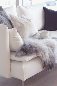 www.thewhitebox.no Scandinavian interior design. Söderhamn sofa from IKEA, Norwegian sheepskin.