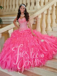 Quinceanera dress in organza fabric. Bodice is fully beaded thruout. The organza skirt is embelished with ruflles all around. Lace up back. Quinceanera Dress #56247
