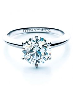 Round Solitaire Diamond Engagement Ring from Tiffany and Co. The solitaire diamond is held by 6-prongs on a platinum band.