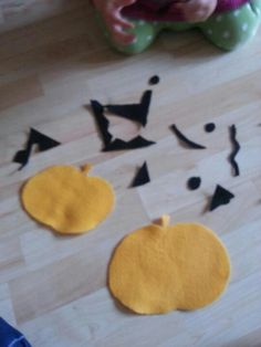 cheap felt cut into pumpkin shapes! Then scary shapes cut out of black... Kids will have hours of fun creating scary faces!!