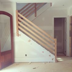 new modern wooden stair rail up in #serenbe #grangehilltownhomes It has some gray paint in its future. (this townhome is modern, one is eclectic, and the third we are calling the modern farmhouse).