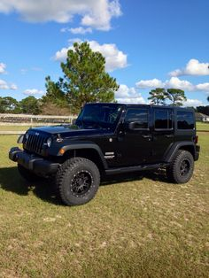 Looking good with the new lift kit, tires, wheels, & tire carrier!  Our 2013 Jeep Wrangler Unlimited Sport