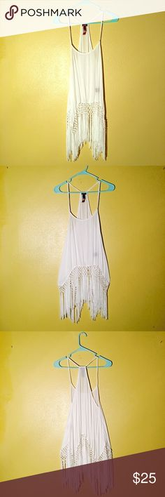☁️White Boho Tapestry Tassle Tank☁️ ☁️This is what dreams are made of!☁️ Fringe your way on to the scene in this beautiful tank by poof! Worn once and looking for a new home! Measurements (flat): bust; 18 1/2 inches, waist: 25 inches, hip: 31 inches, length: 39 inches. Brand for exposure. Free People Tops Camisoles