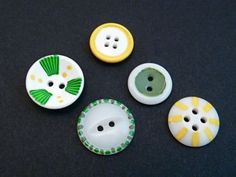 White buttons painted with hobby paint (use Sharpies and nail polish, too)