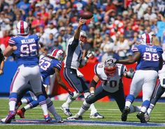 ORCHARD PARK, NY - SEPTEMBER 08: Tom Brady #12 of the New England Patriots throws under pressure from Ron Brooks #33 of the Buffalo Bills at Ralph Wilson Stadium on September 8, 2013 in Orchard Park, New York.New England won 23-21. (Photo by Rick Stewart/Getty Images)