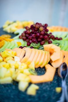 #FreshFruit isn't just #healthy for you + your wedding guests, but it's also #delicious + oh so #pretty! ::Alexis + Jon's delightful wedding in Princeton, Massachusetts:: #colorful #catering #weddingcatering #grapes #cantaloupe #honeydew #melon #pineapple #prettyfood