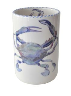 This coastal wine bottle holder decorated with a gorgeous Blue Crab is a wonderfully versatile piece for any coastal kitchen