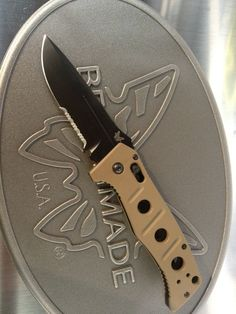Benchmade 2750 Adamas. Laser printing on blade, fully custom knife: colors engraving everything by bench made.  Wonderful gift for husband or in my case, me.  Put some nick name on the blade or corny saying--awesome!!