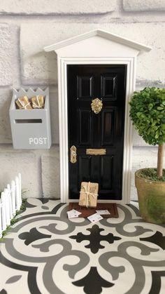 Post arrives outside our NEW black Fairy Door! Available on our website now!! Diy Fairy Door, Tooth Fairy Doors, Fairy Garden Doors, Mini Fairy Garden, Fairy Door Accessories, Diy Projects For Couples, Elf Door, Modern Kids Bedroom, Monochrome Interior