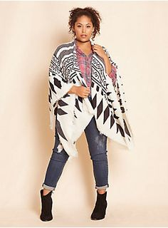 """We we're never all that great at geometry, but we think we got the shapes just right right on this ruana wrap. The lighter-than-air-but-still-cozy buttery-soft white knit takes shape with black geo patterns dotting the open-armed style.<div><br></div><div><b>Model is 5'8"""", size 1<br></b><div><ul><li style=""""LIST-STYLE-POSITION: outside !important; LIST-STYLE-TYPE: disc !important"""">One size</li><li style=""""LIST-STYLE-POSITION: outside !important; LIST-STYLE-TYPE: disc !important"""">Ac..."""