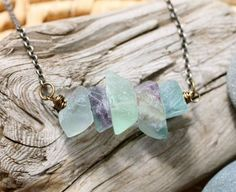 This necklace is inspired by my Five Deep Breaths practice that invites you to pause and recenter by taking five deep breaths. (Try it. Doing it several times a day just might change your life.) Fluorite gemstones are used to encourage listening to your intuition.