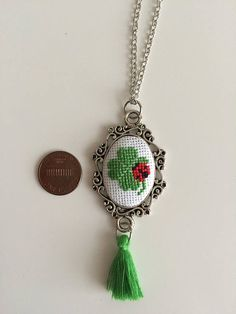 Handmade elegant cross stitch necklace with detailed shamrock pattern. I can adjust the length of the chain if you like. Let me know if you have any question