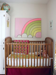 such a cheerful space for baby. check out the vintage sheet for the crib.