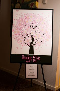 Cherry Blossom Guest Book | Photography: D. Park Photography. Read More: http://www.insideweddings.com/weddings/a-black-white-pink-wedding-in-august-inspired-by-cherry-blossoms/617/