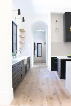 kitchen space // wood floors // black cabinets // white walls // home decor