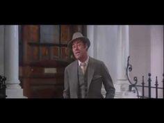 Rex Harrison as Henry Higgins