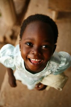 """Smiling Girl from Ghana"" by CompassionInternational on Flickr - Ghana, West Africa"