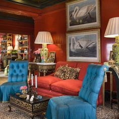 Turquoise tufted slipper chairs, red walls and couch, yellow Chinoiserie lamps, leopard pillows - gorgeous- Thomas Britt