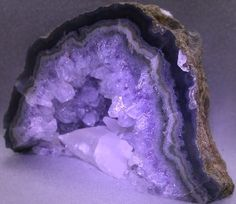 Amethyst crystals are hexagonal and can occur as tall prismatic crystals or short stubby ones. The crystals often have horizontal striations on their sides or faces. The transparent prismatic crystals can be found in clusters in an incrustation (rock cavity). This lining of crystals is also known as a druse and in a nodular stone is commonly called a geode.