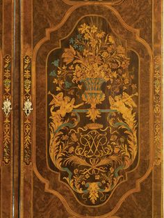 A RARE AND IMPORTANT LOUIS XIV SCAGLIOLA-INLAID, PART-EBONIZED BURR WALNUT AND FRUITWOOD MARQUETRY ARMOIRE, BY THOMAS HACHE CIRCA 1695