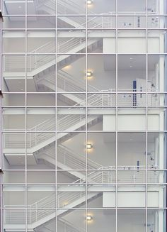 Clean steel stairs with minimal stick built curtain wall.