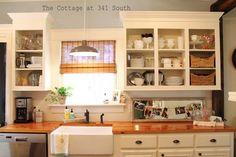 white cabinets with butcher block countertops