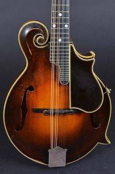 "Gibson F-5, signed by Lloyd Loar on July 9, 1923. Serial number 73725, does not have the ""side binding"" like Monroe's, which was signed on the same day, but it does have the killer tone we all expect from a July 9. The mandolin is well-played - understandably, considering its sound. In its original case (which is also well-used). $175,000hoto for Ad 86010"